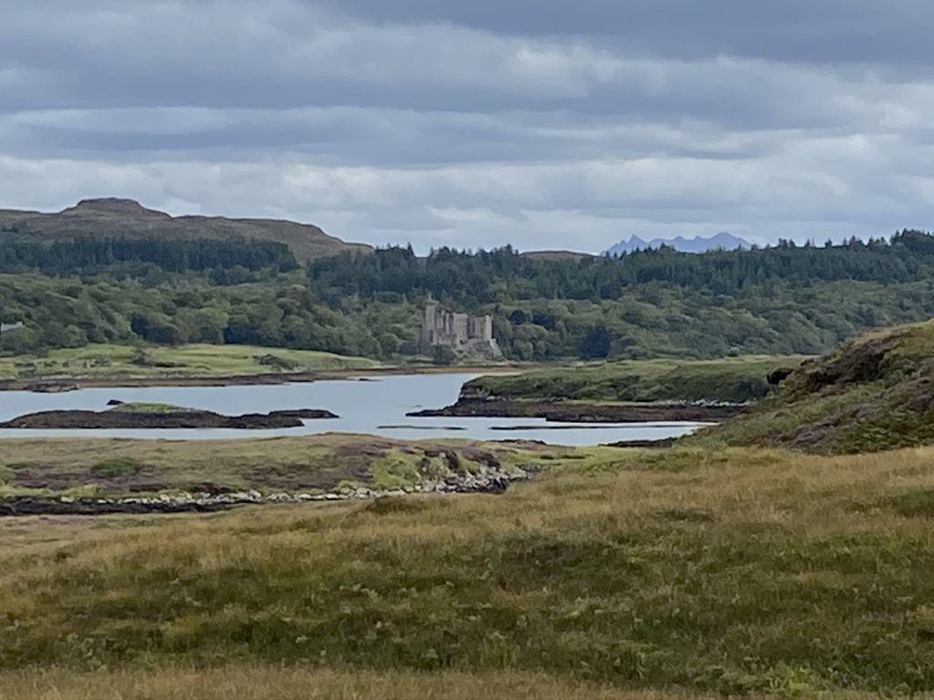 Dunvegan Castle across the water as seen on one of day walks in Skye