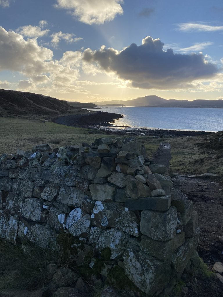 Looking over a dry stone wall across the loch