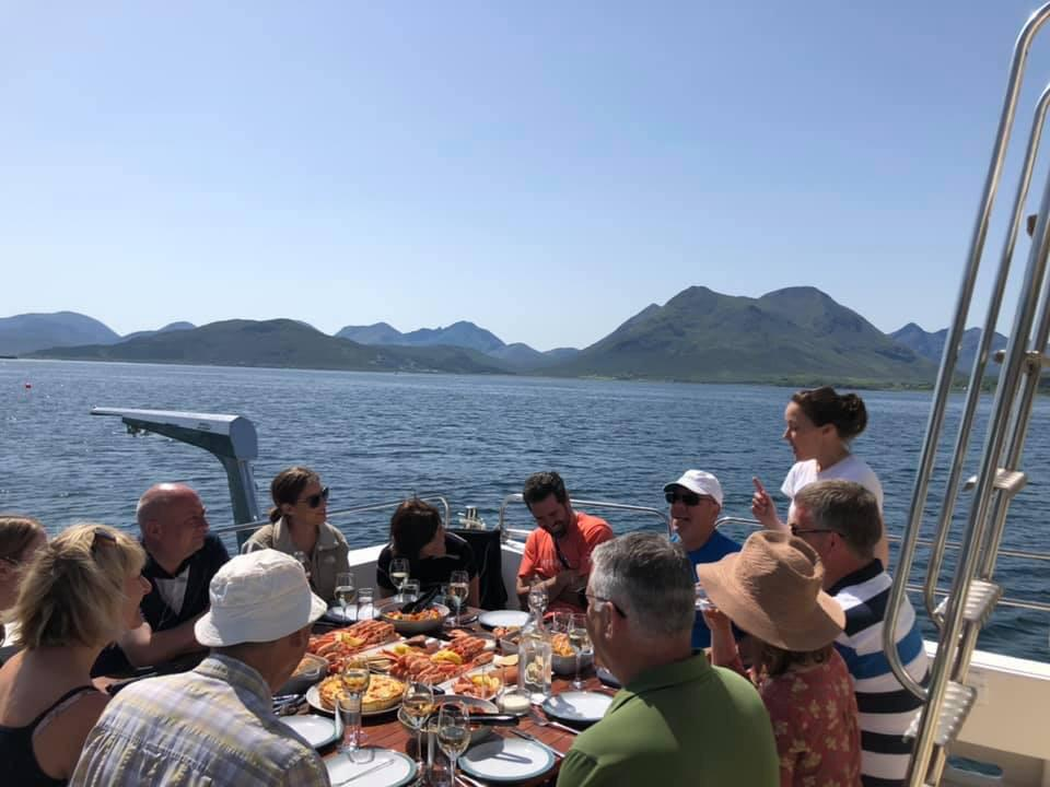 Guests sat on the deck of Seaflower Skye in glorious sunshine.