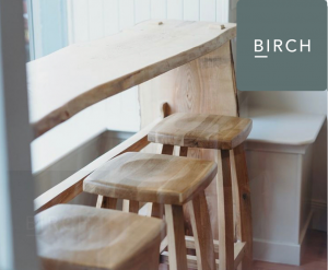 Three wooden stools at Birch cafe in Portree.