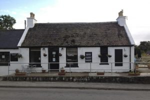The Bakery Dunvegan a low level white stone building.