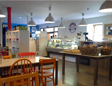 A view inside Skye Bakery Company's cafe with tables and chairs.