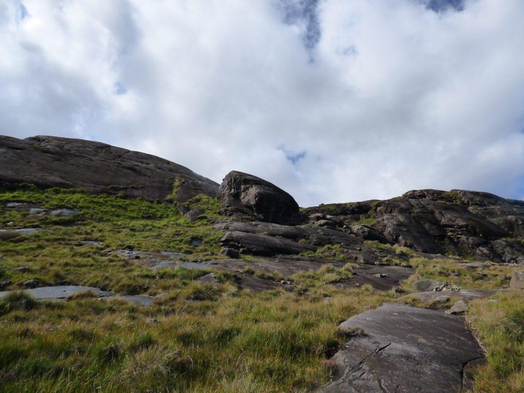 Looking up the black slab rocks